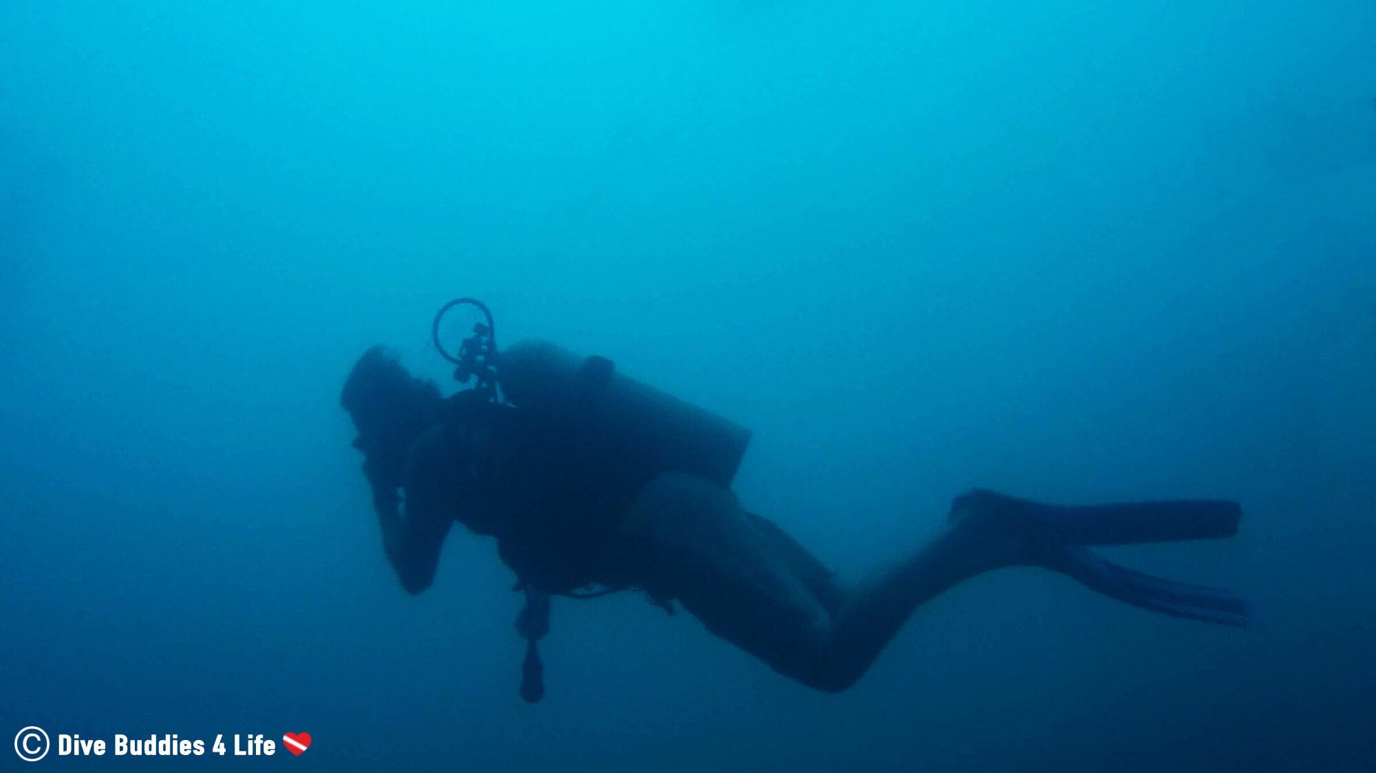 Silhouette Of A Scuba Diver Clearing Their Ears Underwater In Laguna Apoyo, Nicaragua