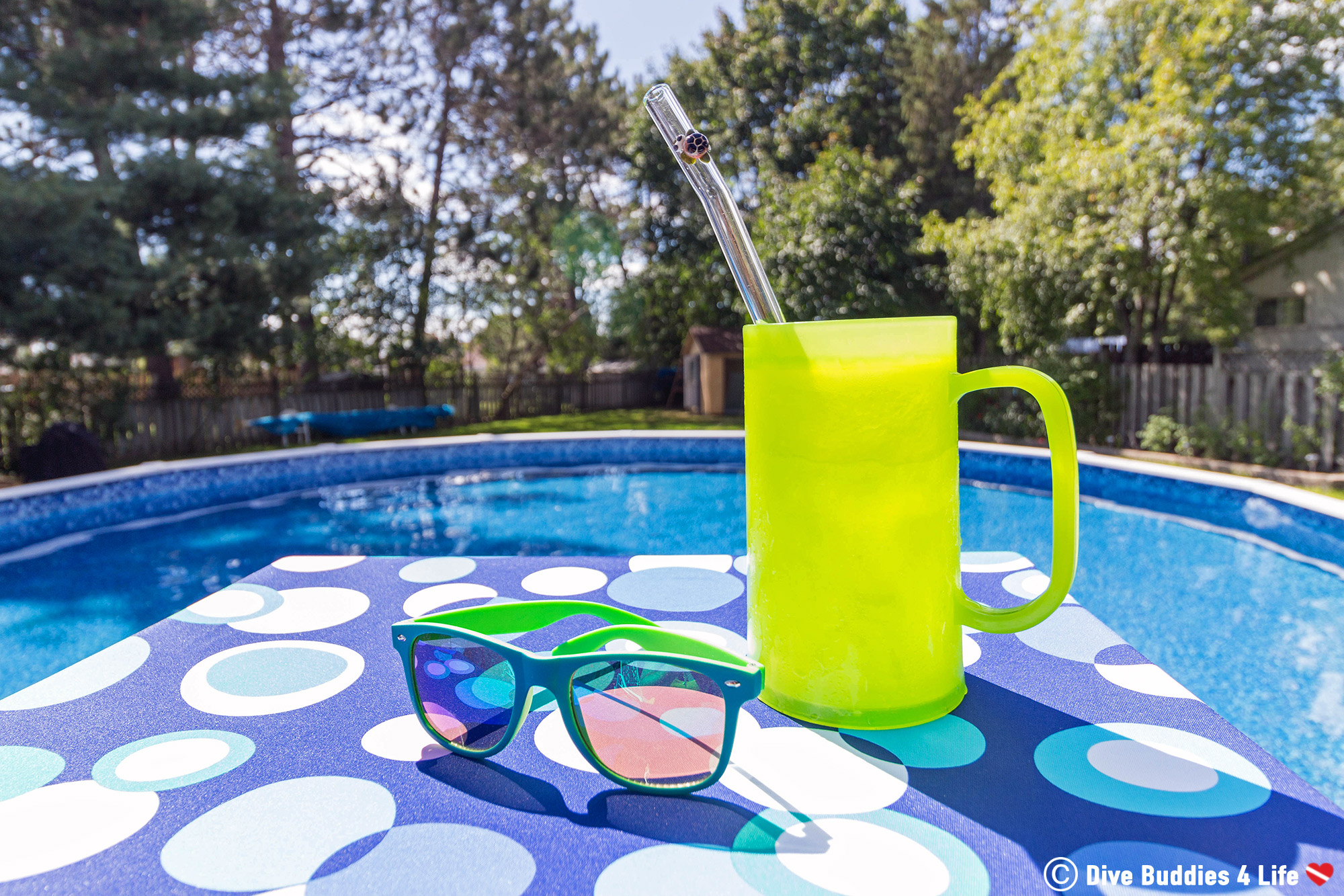 Sipping With An Eco Friendly Glass Straw Pool Side