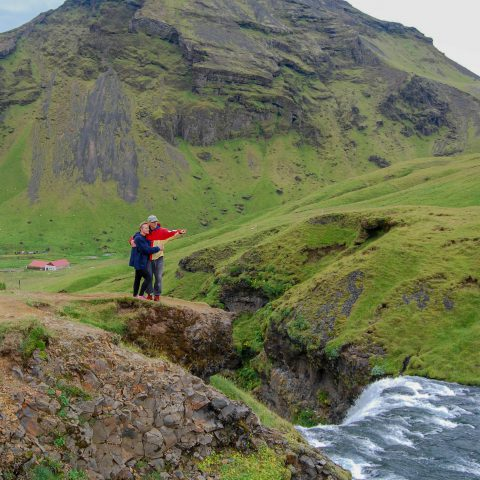 Iceland's Skogafoss with Mom and Dad Looking Out