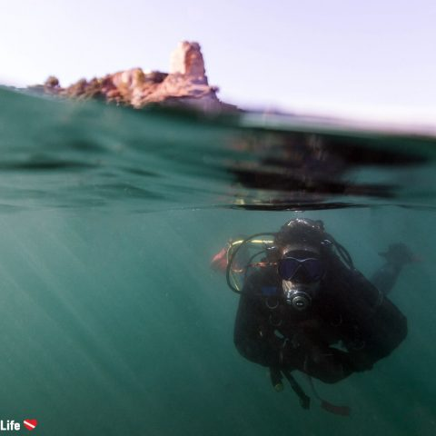 Split Photograph Of Joey Scuba Diving With Roman Ruins On Land Behind Him In Baiae, Naples, Italy, Europe