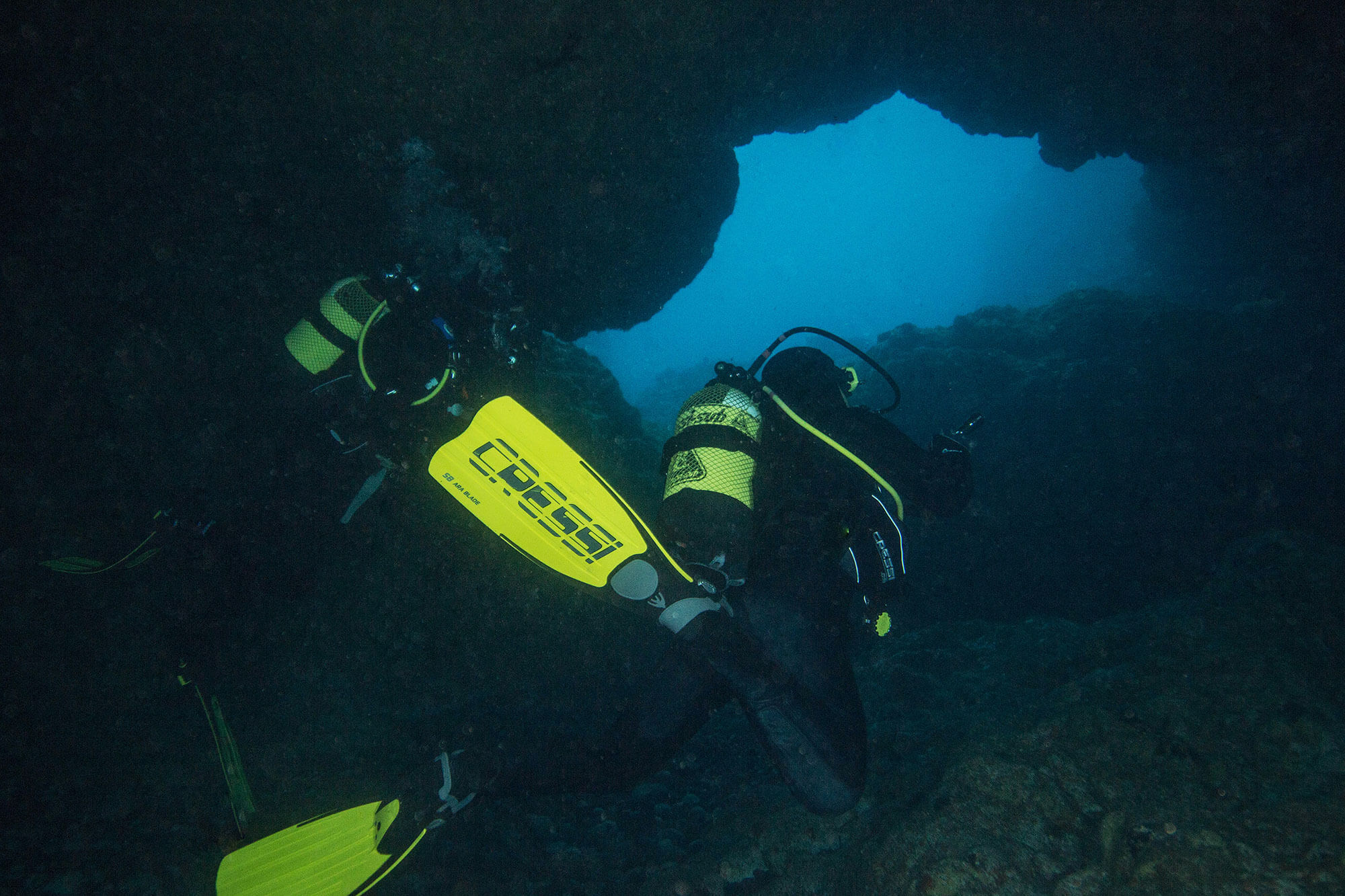 Swimming into the Arcos de Calora Caves In The Azores