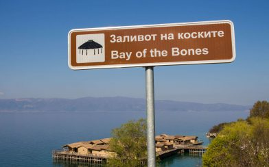 The Bay Of Bones Sign With The Houses In Behind