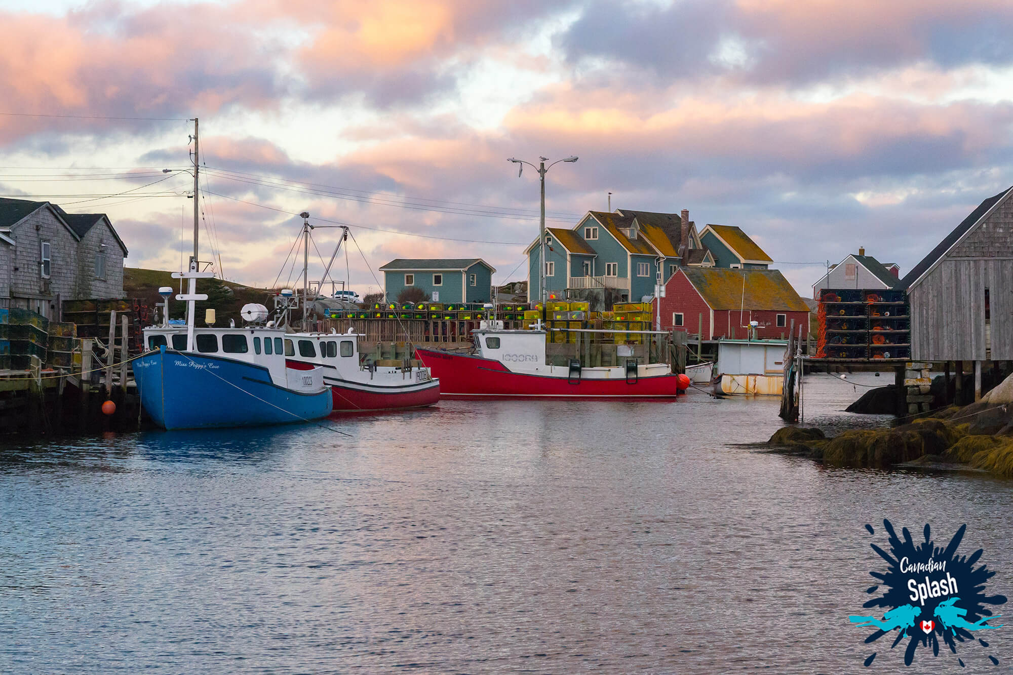 The Boats And Fishing Village Of Peggy's Cove On St Margarets Bay, Halifax, Nova Scotia, Canadian Splash