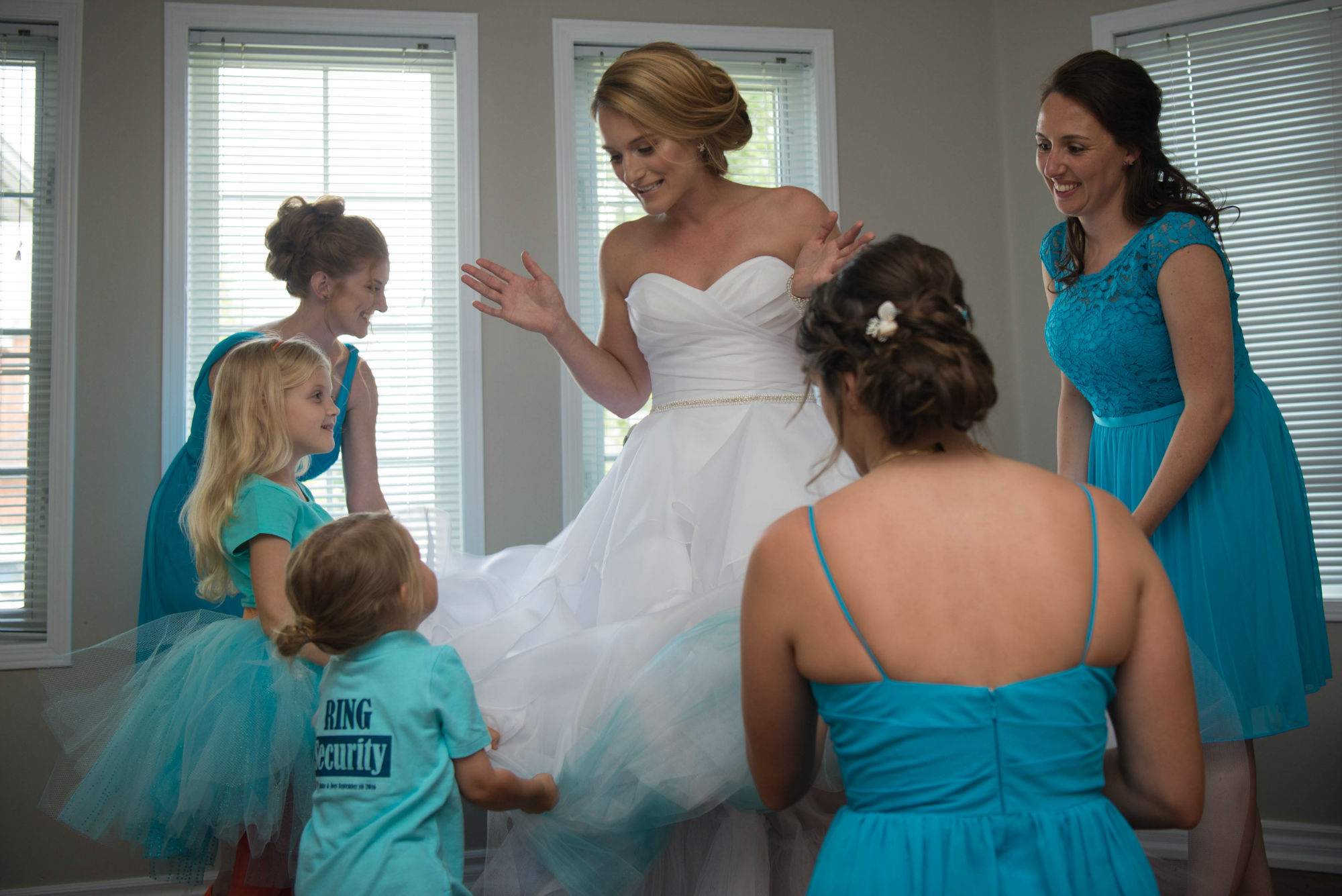 The Bridal Party Shaking The Brides Dress