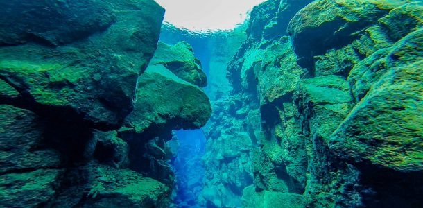 The Clear Water Of The Silfra Fissure With The Scuba And Snorkel Entry Ladder In The Distance, Iceland, Europe