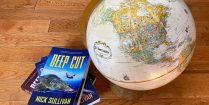 The Deep Cut Scuba Diving Novel Beside A Globe