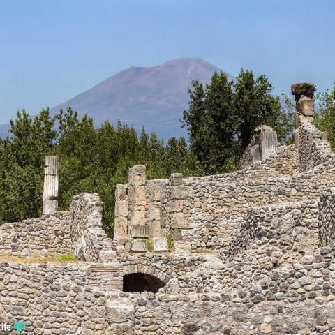 The Ruins Of Pompeii With Mount Vesuvius In The Background In Naples, Italy Close To The Amalfi Coast
