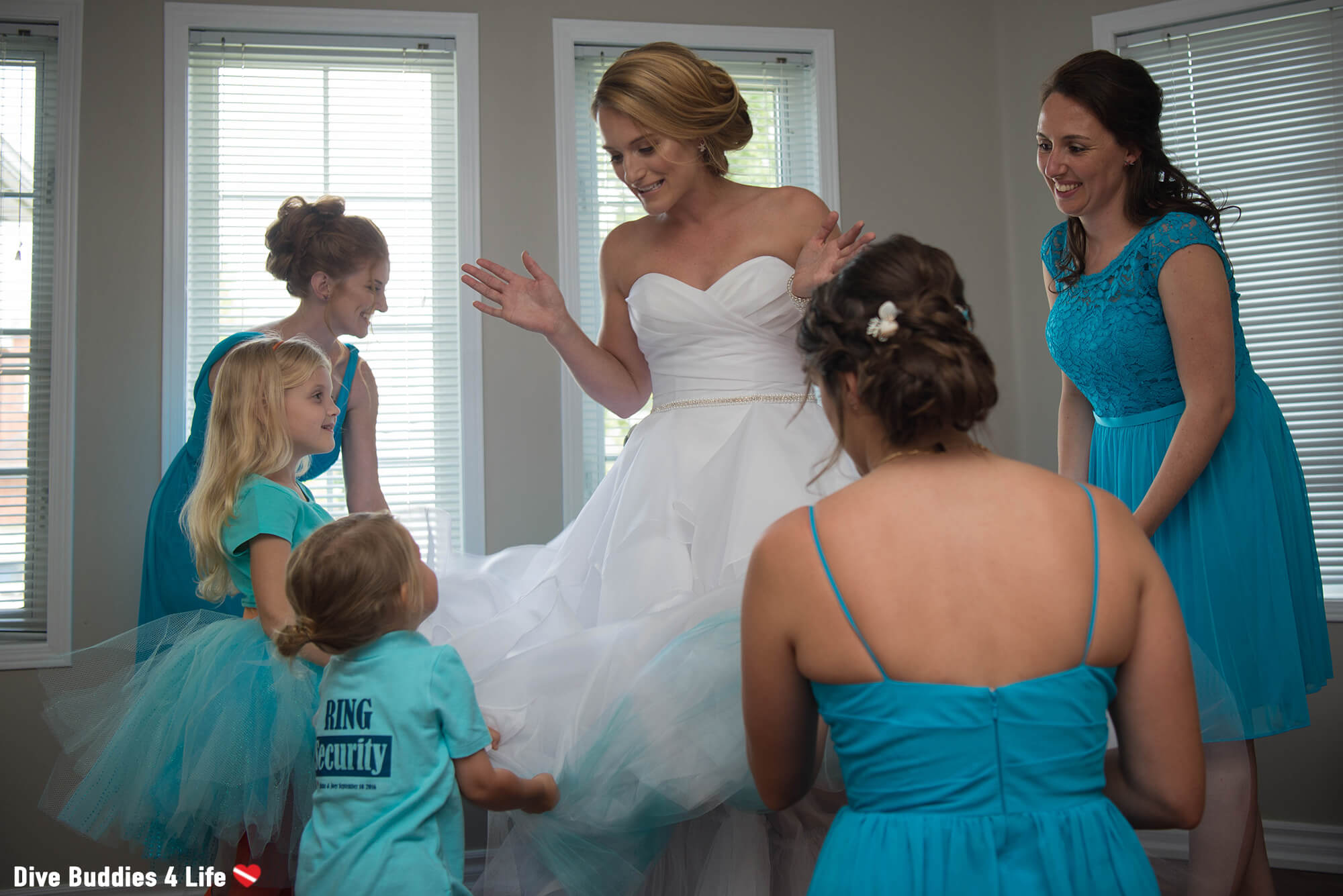 The Wedding Party Showing Off The Brides Scuba Blue Under Her Wedding Dress