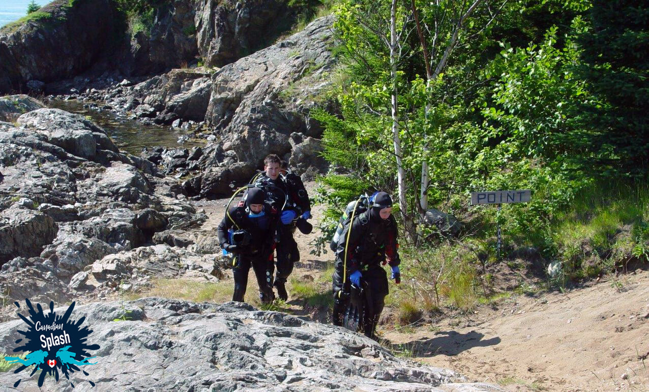 Three Scuba Divers Coming Out Of The Water At The Point Dive Site On Deer Island, New Brunswick, Canadian Splash Scuba Diving