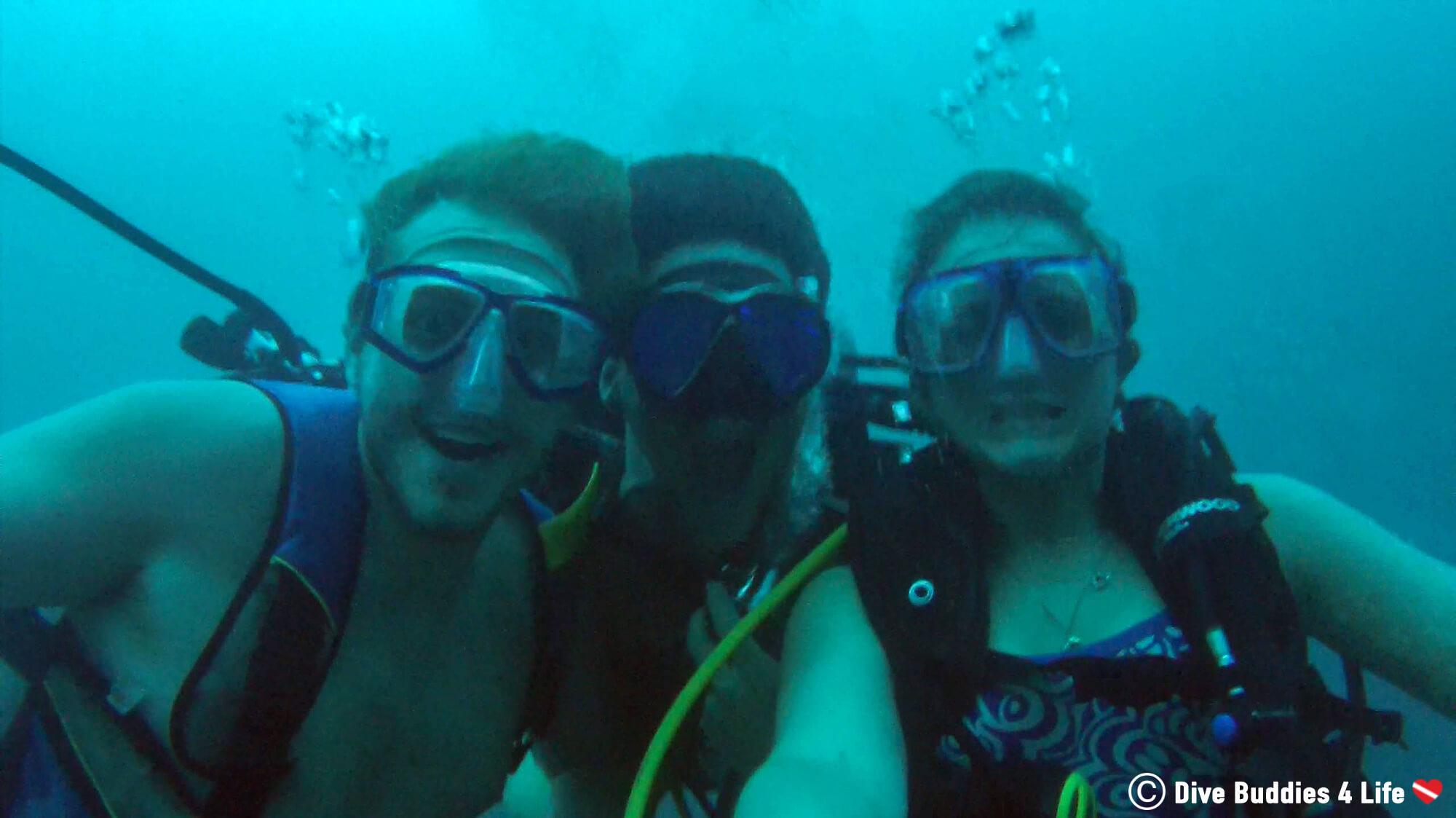 Three Scuba Divers Underwater In A Volcanic Crater In Laguna Apoyo, Nicaragua