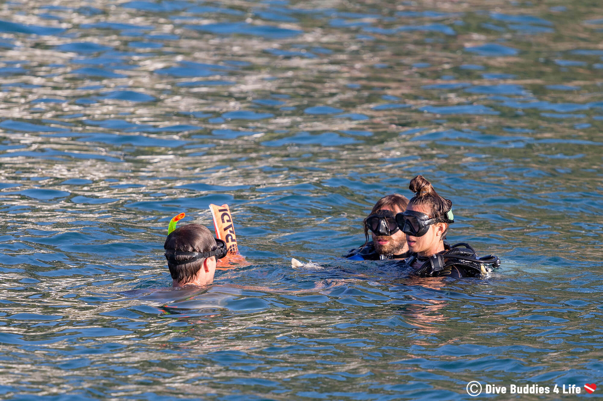 Three Scuba Divers And A Safety Buoy Deployed From Depth, Mexico