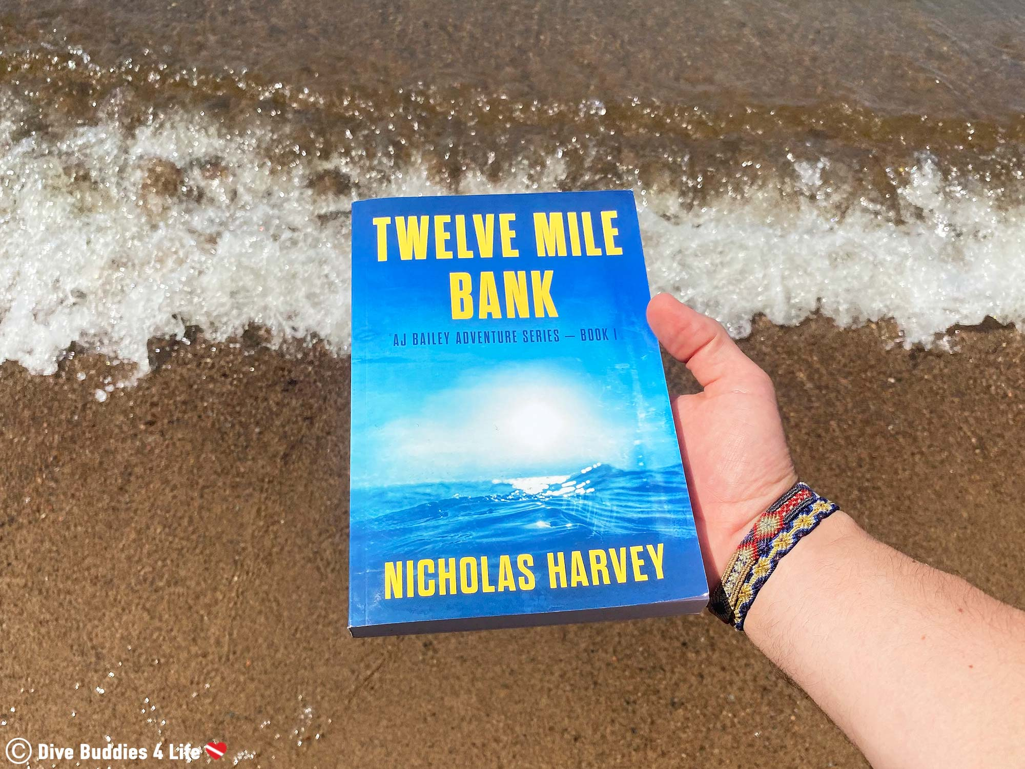 Twelve Mile Bank Scuba Diving Book With The Waves Crashing The Shore In The Background
