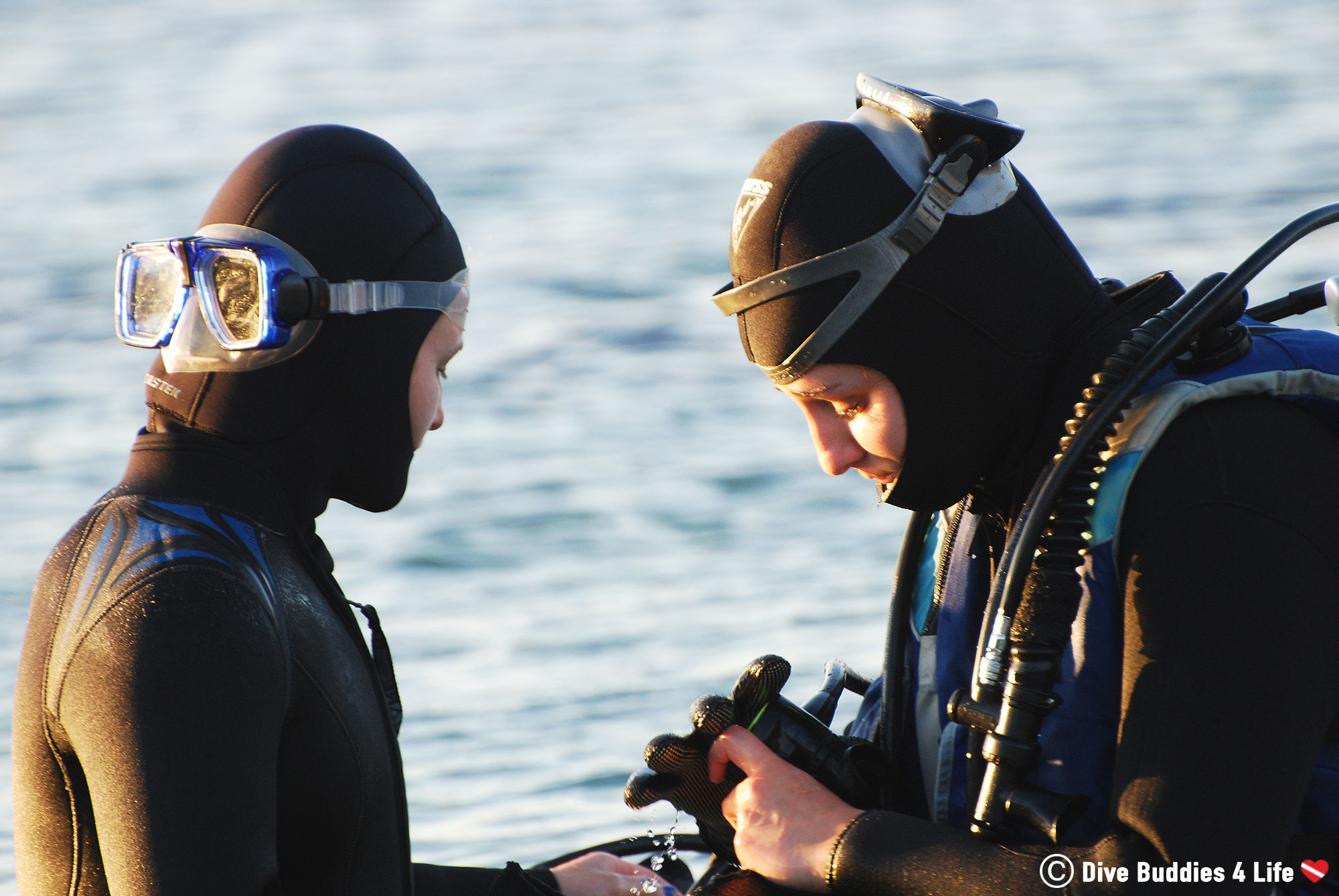Two Female Divers Preparing Their Gear For Scuba Diving