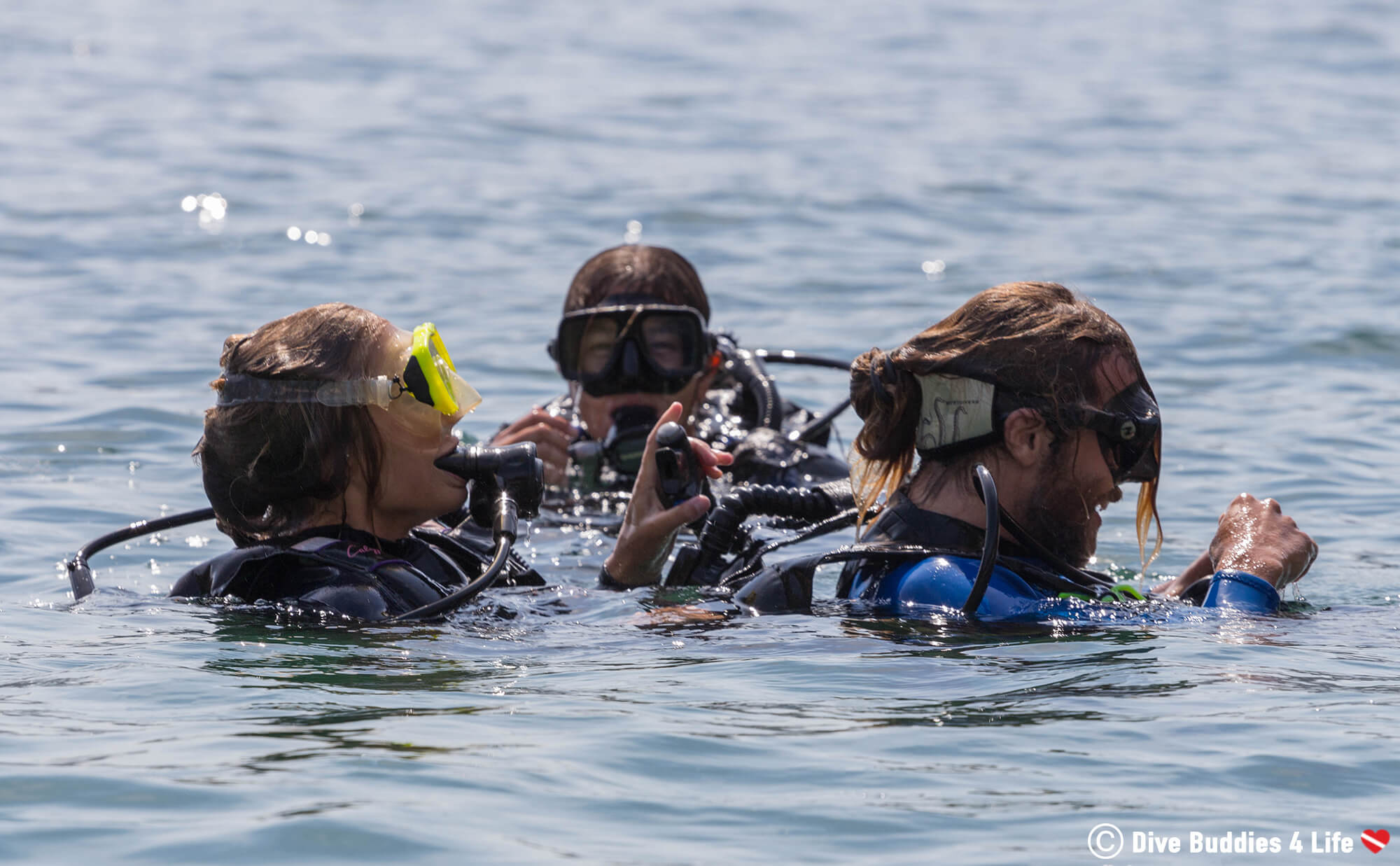 Two Rescue Scuba Divers Performing On Of The In Water Situations While A Dive Instructor Observes